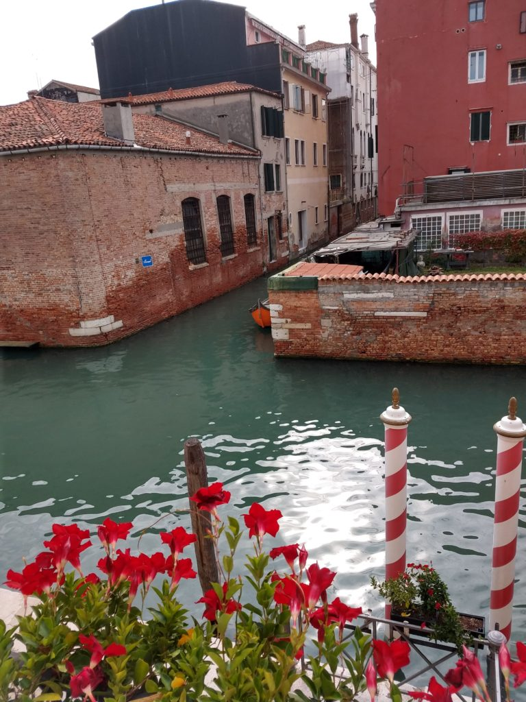 view of the canal from a suite in hotel ai mori d'oriente venice