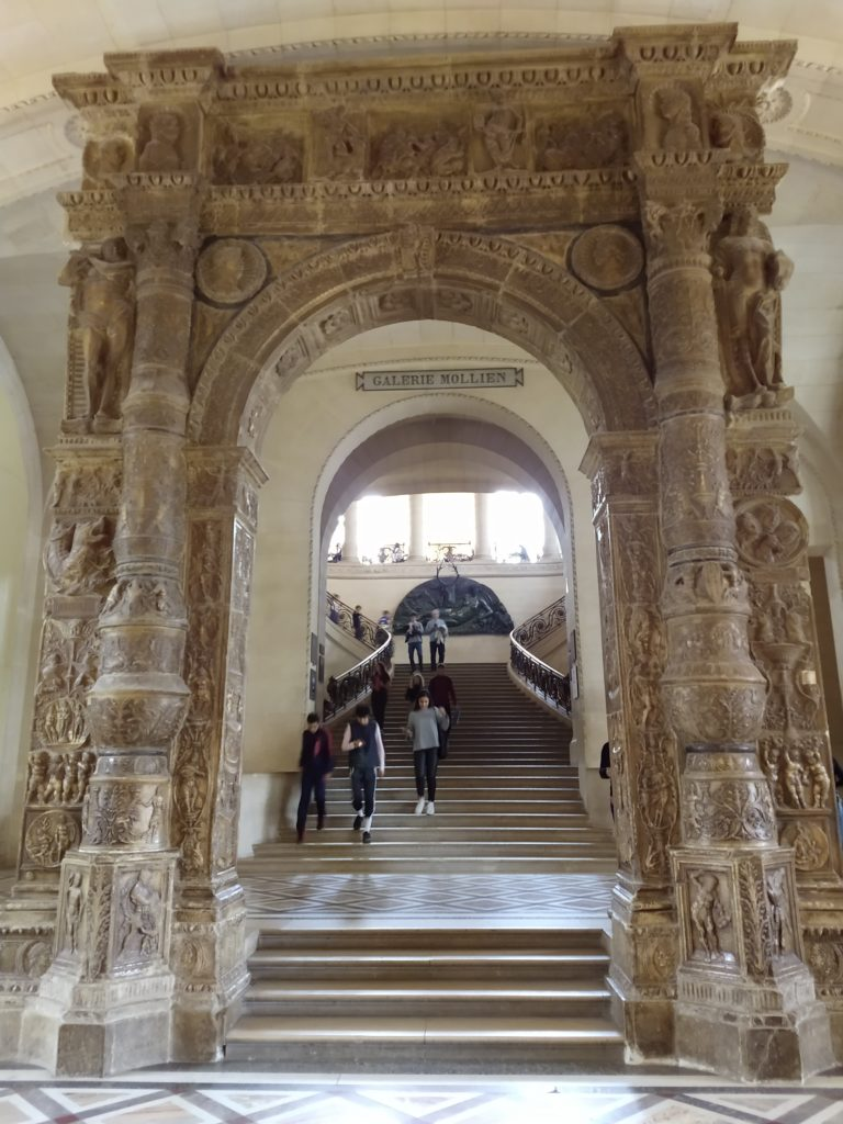 a stone archway inside the louvre museum