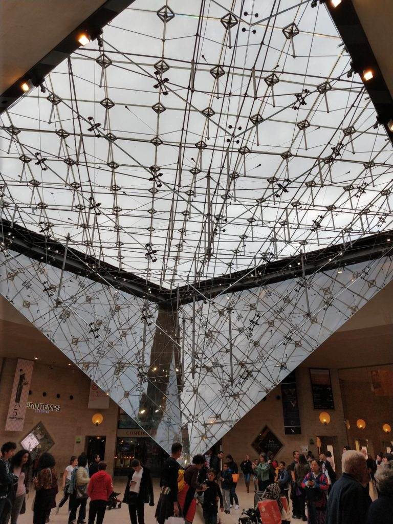 the view of the bottom of the louvre pyramid