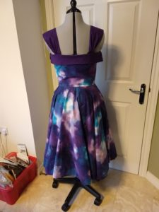the galaxy dress from the back on a dress form