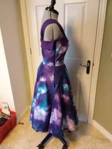 the galaxy dress from the right side on a dress form