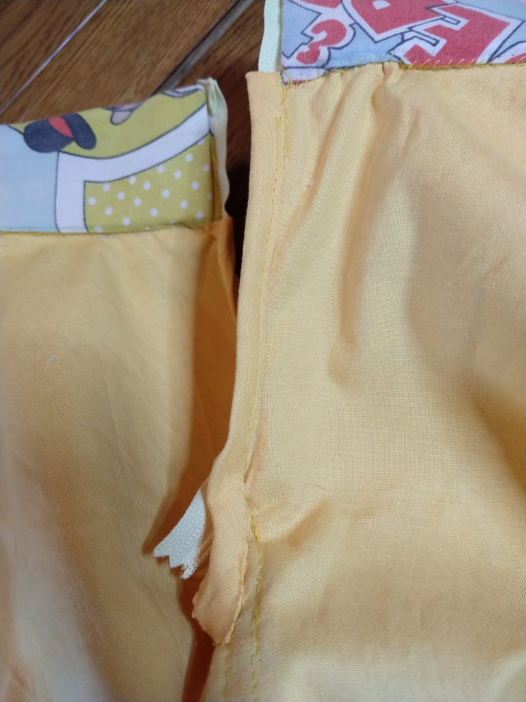 the inside of the tom & jerry skirt showing the bound zip