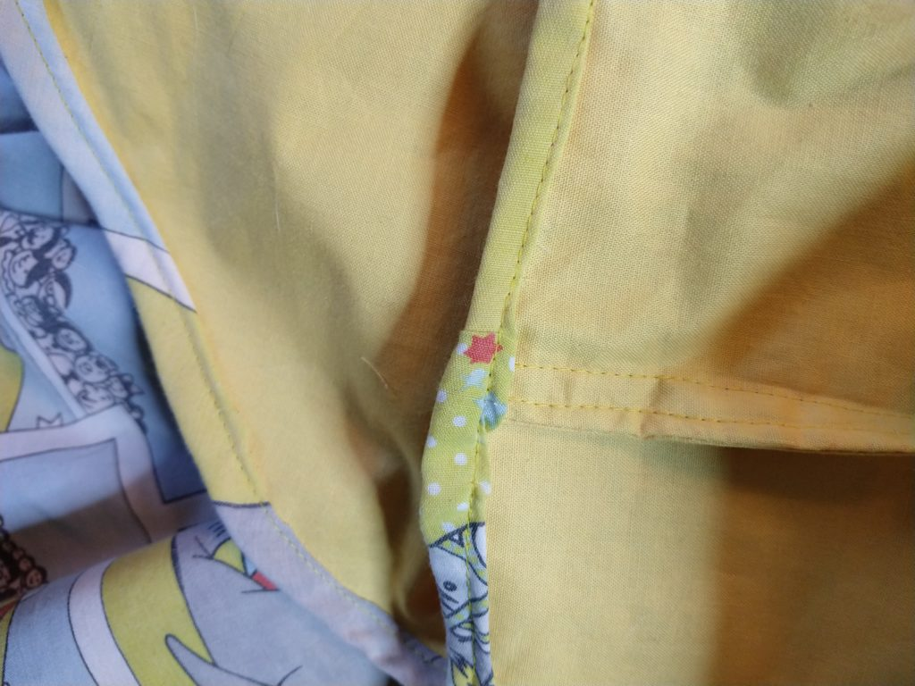 the inside of the tom & jerry skirt showing the hem