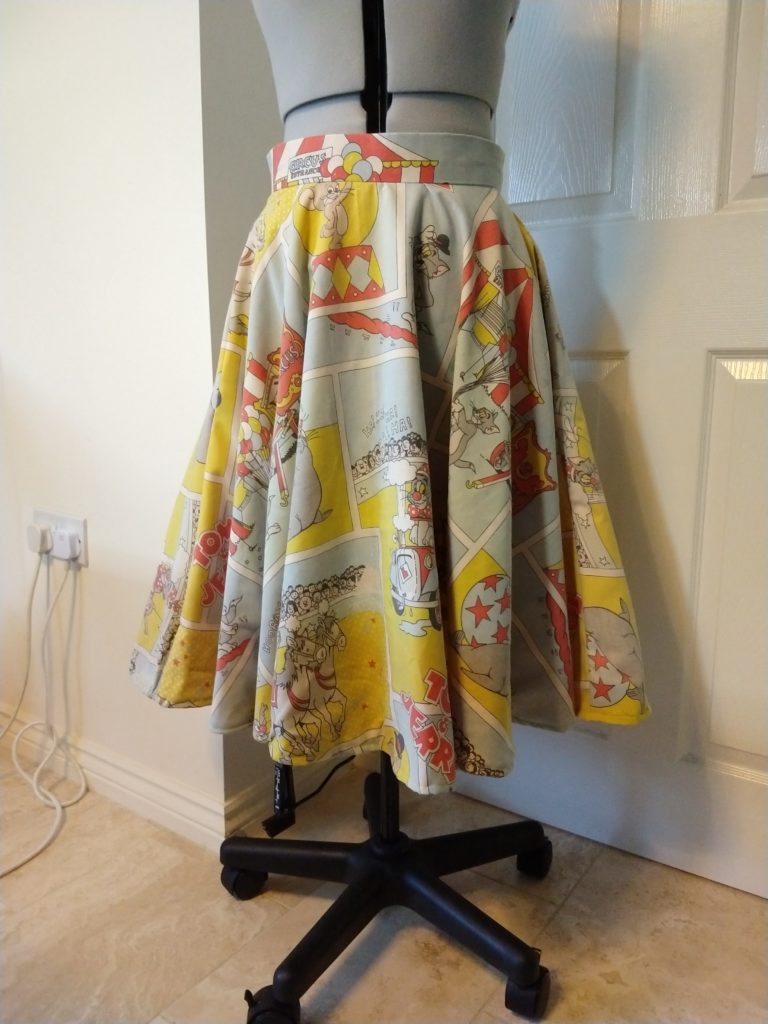 the tom & jerry skirt from the front on a dress form