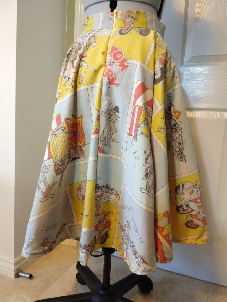 the tom & jerry skirt from the back on a dress form