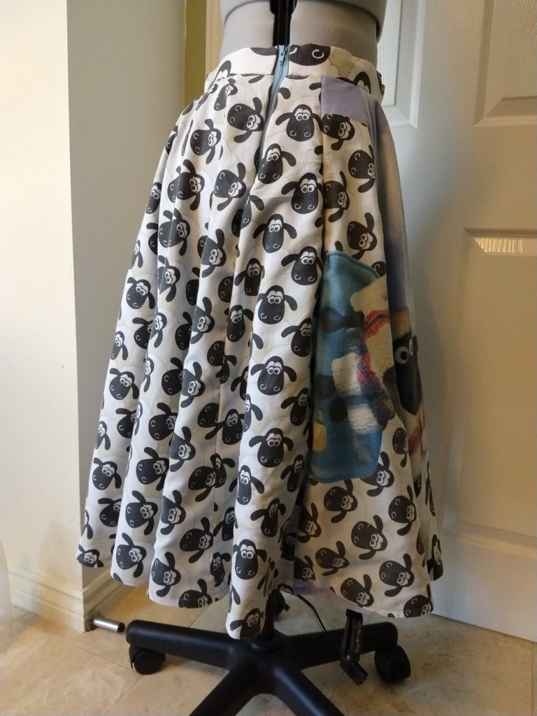 the wallace & gromit skirt from the right side on a dress form