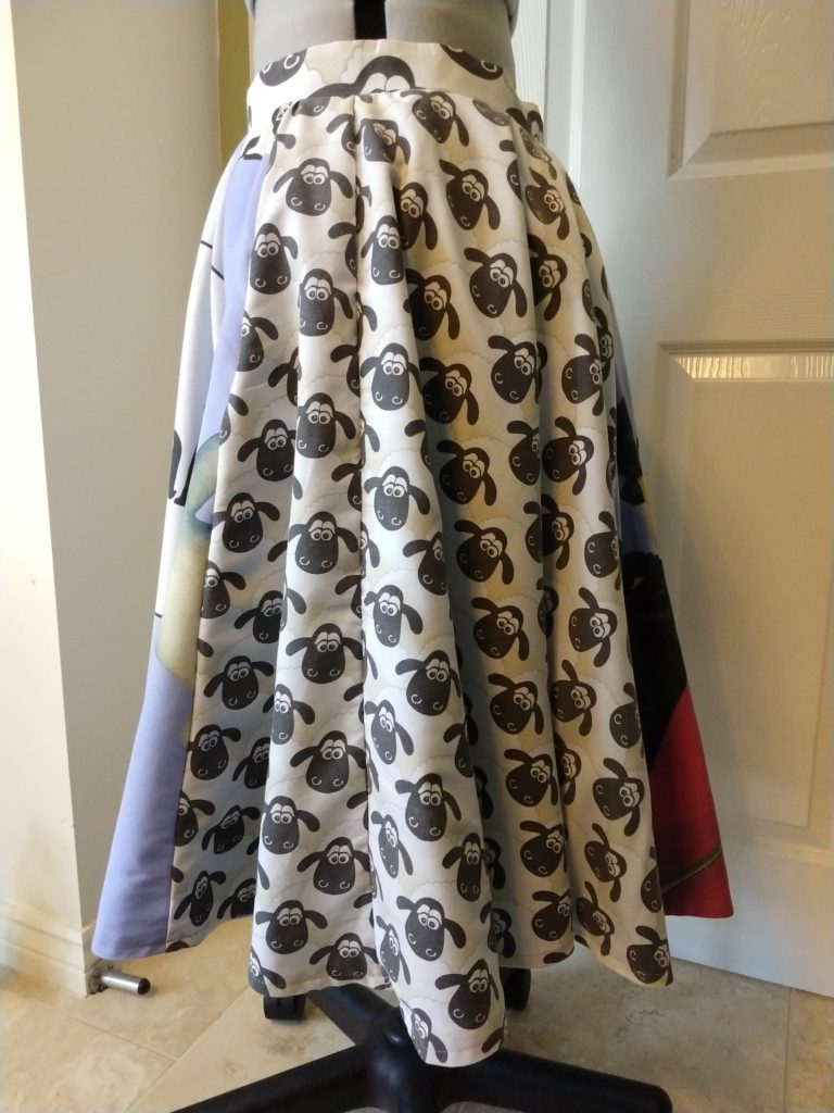 the wallace & gromit skirt from the left side on a dress form