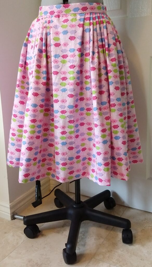 the pig skirt from the front on a dress form