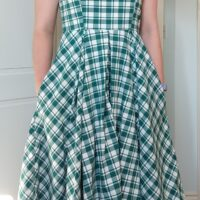 front view of michelle modelling the chequered dress with her hands in the pockets