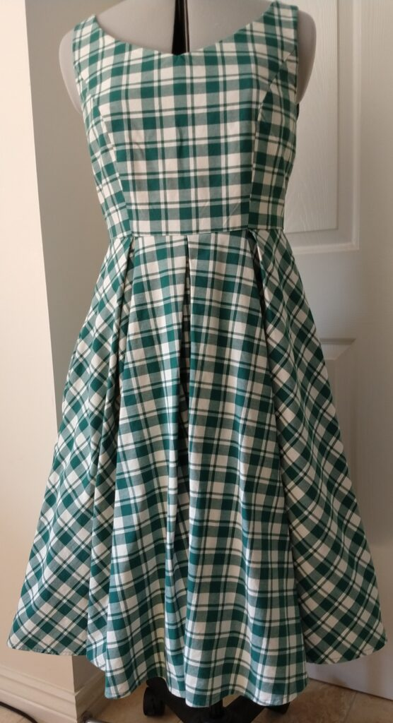 the chequered dress from the front on a dress form