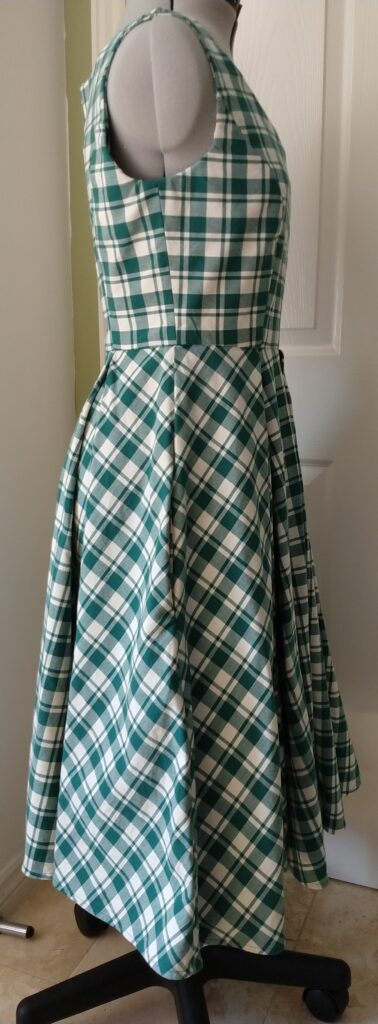the chequered dress from the right side on a dress form
