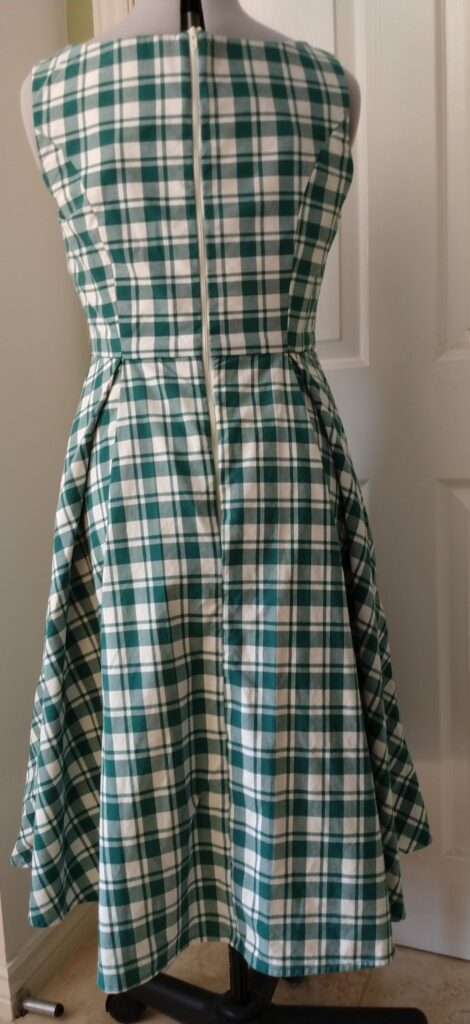 the chequered dress from the rear on a dress form