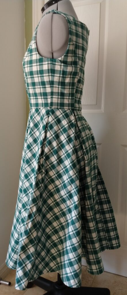 the chequered dress from the left side on a dress form