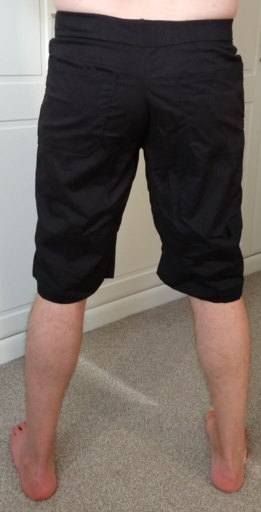 rear view of tom modelling the climbing shorts