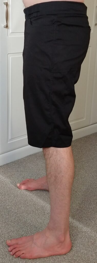 tom modelling the climbing shorts from the left side