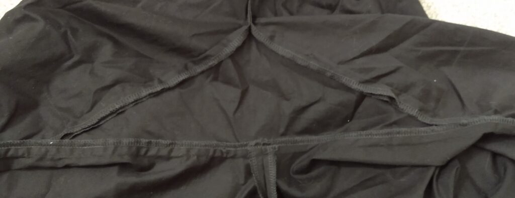 the inside of the climbing shorts showing the triangle piece at the crotch