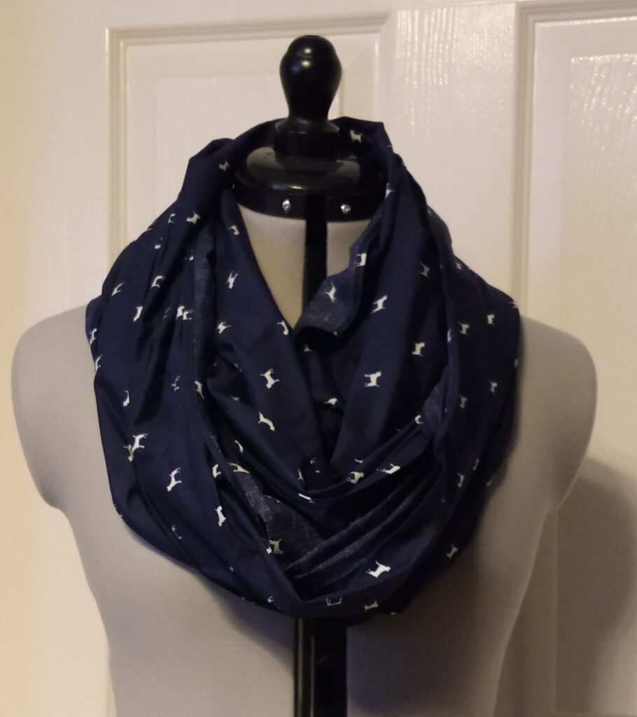 a dark blue snoody buff with a white dog pattern