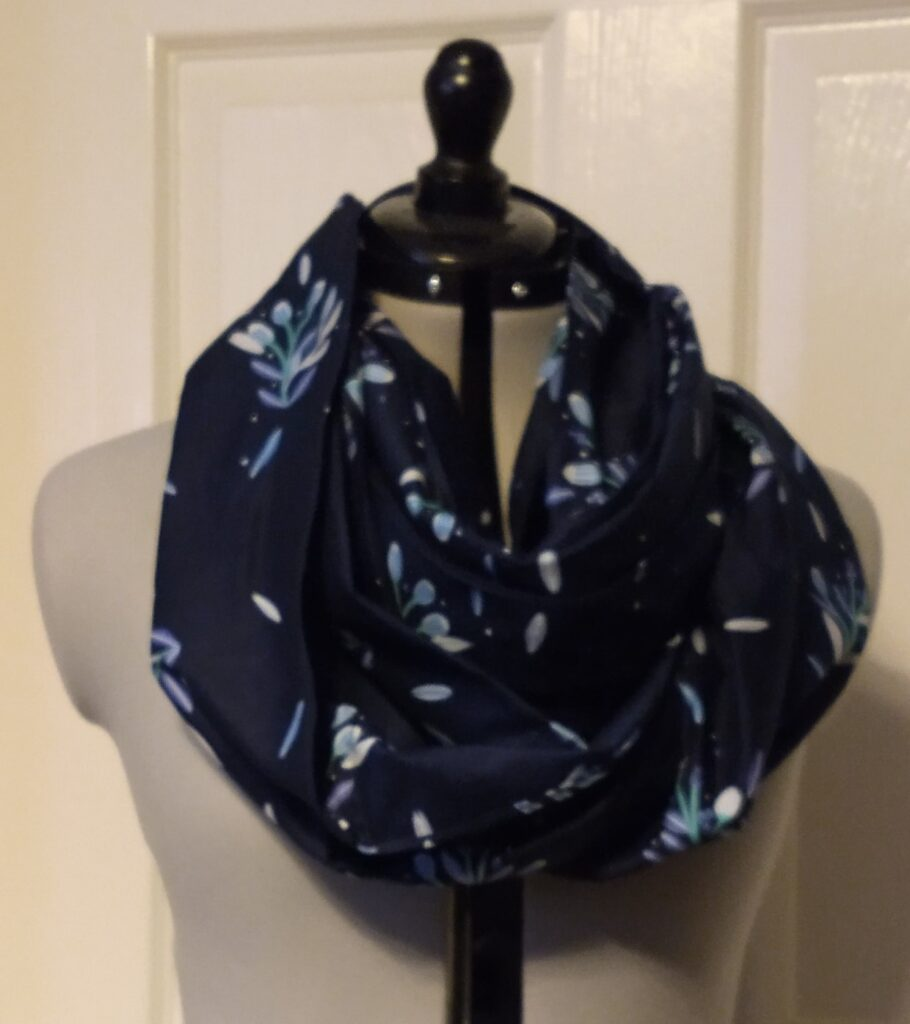 a dark blue snoody buff with a pale blue flower pattern