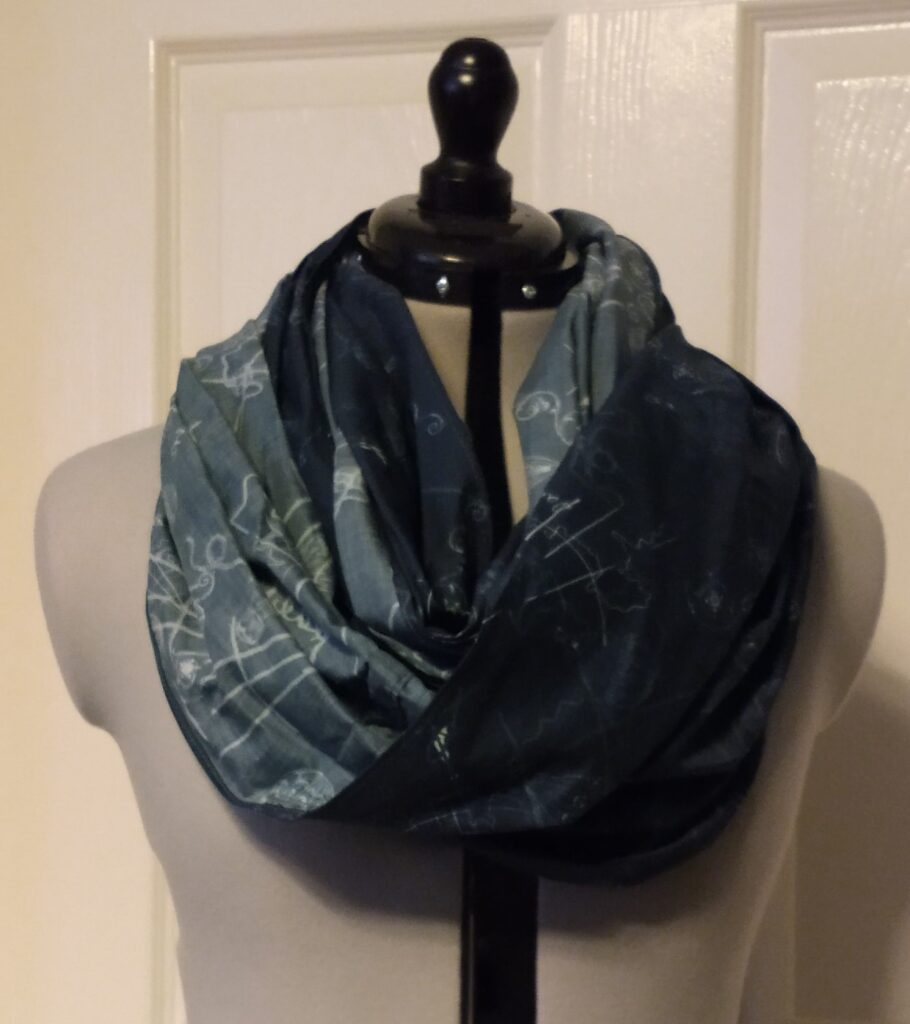 a navy blue snoody buff with a silver hot air balloon pattern