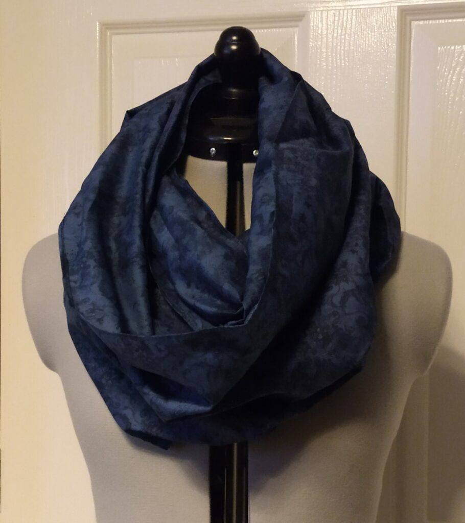 a dark blue snoody buff with a black flower pattern